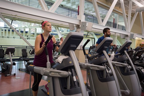 USI Recreation, Fitness and Wellness Center visitors use elliptical trainers