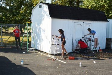 USI students paint a shed at the American Red Cross in Evansville during Service Saturday