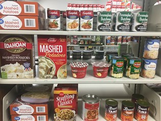 Food on the shelves at Archie's Closet