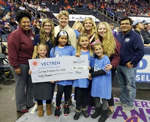 USI College Mentors for Kids representatives accept a check from the Vectren Foundation